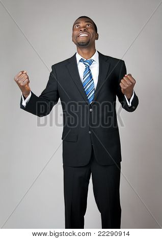 Emotional Businessman Praying In Hope