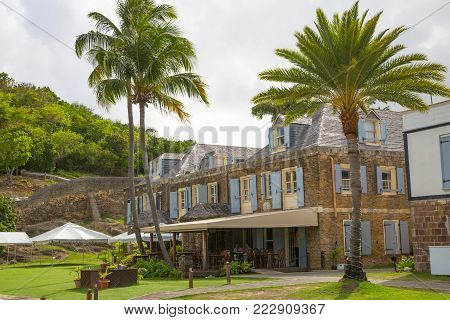 Antigua, Caribbean islands, English Harbour - May 19, 2017: English harbour international preserve area. view with sailing boats and historical buildings Nelson's time