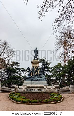 SEVASTOPOL, RUSSIA - MARCH 19, 2011: Monument to general Totleben against grey cloudy sky. Eduard Ivanovich Totleben was a Baltic German military engineer and Imperial Russian Army general