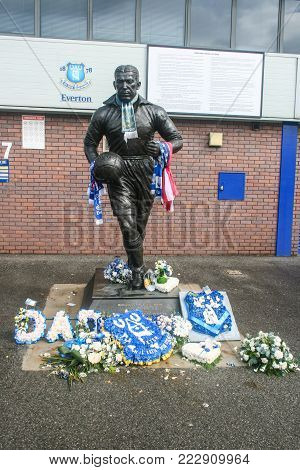LIVERPOOL, ENGLAND - APRIL 22, 2012 : A statue of Dixie Dean a legendary footballer and goalscorer of Everton football club locates outside Goodison Park in England.