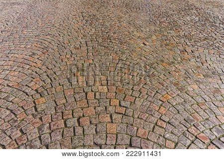 Close-up of Paving Stones in Sunlight. View from above to many Paving Stones on the Street. Natural Stone Texture. Backgrounds and Textures.
