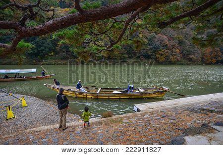 Kyoto, Japan - Nov 28, 2016. Boats On Hozu River At Arashiyama In Kyoto, Japan. Arashiyama Is A Nati