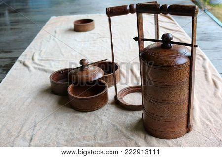 Coconut wood ware, food carrier on white background in Thailand