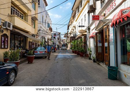 STONE TOWN, ZANZIBAR - JANUARY 9, 2015: Street of Stone Town on sunny day. Stone Town is the oldest part of Zanzibar City which was a UNESCO World Heritage Site in 2000