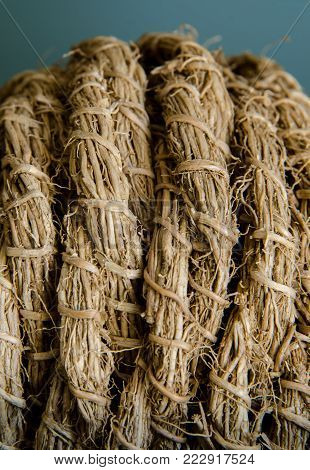Tightly woven twine and wicker ropes form a decorative ball
