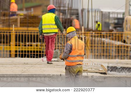 Workers  put reinforcements  on the construction site