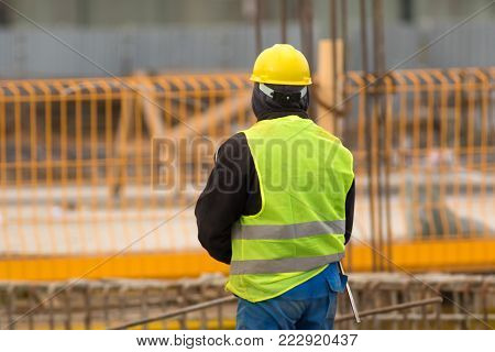 Worker on with yellow helmet the construction site