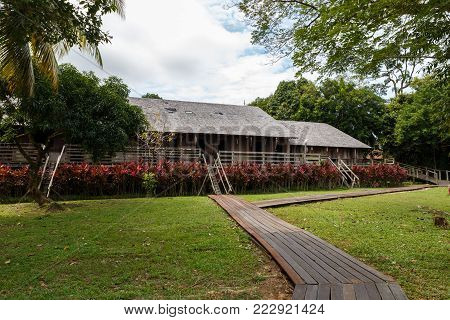 Iban longhouse. Traditional wooden houses in the Kuching to Sarawak Culture village. Borneo, Malaysia