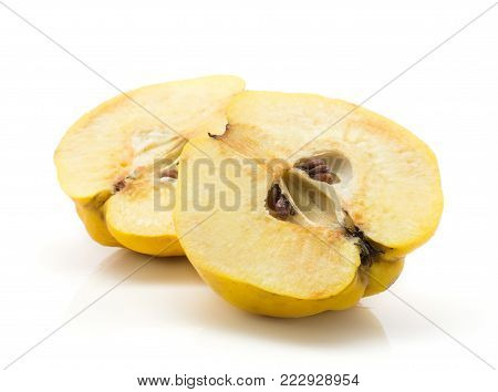 Yellow quince two halves with seeds isolated on white background raw ripe