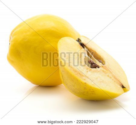 Yellow quince one whole and one half isolated on white background raw ripe