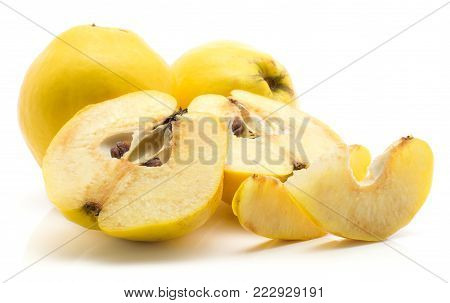 Sliced quinces set isolated on white background two whole ripe yellow raw two halves with seeds two slices