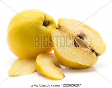 Yellow quince set one whole, half and two slices without seeds, isolated on white background raw ripe