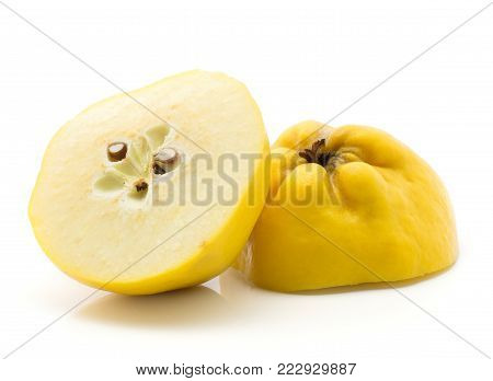 Sliced quince halves isolated on white background raw yellow cut in half