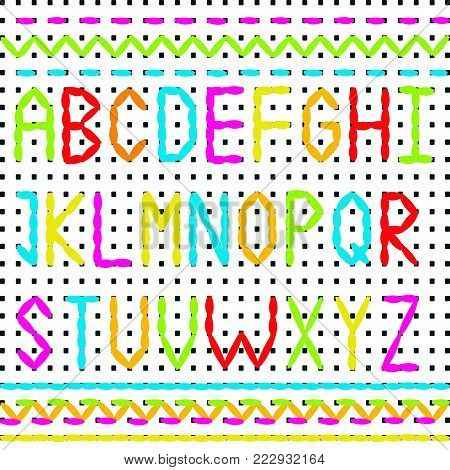 Embroidered alphabet and sewing stitch borders on white