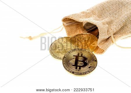 Bitcoin cryptocurrency falling out of burlap sack isolated on white background. Crypto currency electronic money for web banking and international network payment. Selective focus