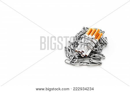 Quit smoking. Cigarettes in chains on white background.