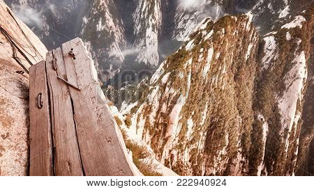Plank trail at Mount Hua, worlds most dangerous hike, color toned picture, China.