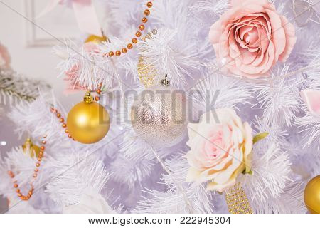 Festive New Year background. Christmas card. Toy hanging on a white pine tree. Celebrate the New Year. To celebrate Christmas. Celebrate the holiday. Greeting card with celebrate background. Celebrate background concept