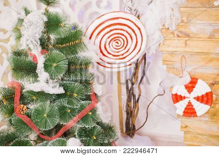 Festive New Year background. Christmas card. Toy hanging on a green pine. Celebrate the New Year. To celebrate Christmas. Celebrate the holiday. Greeting card with celebrate background. Celebrate background concept
