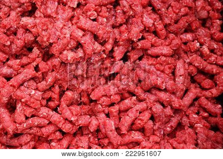 Background or texture - minced meat from fat and meat close-up. Processing of lard in the food industry for making sausages and meat delicacies.
