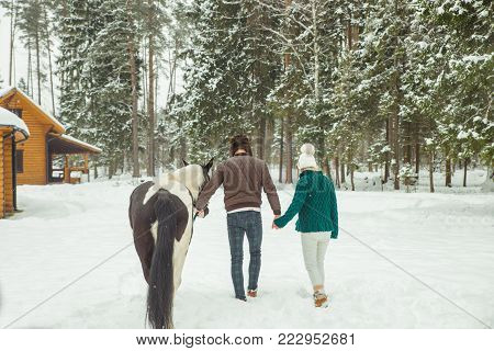 loving couple with horse on ranch. Love story.