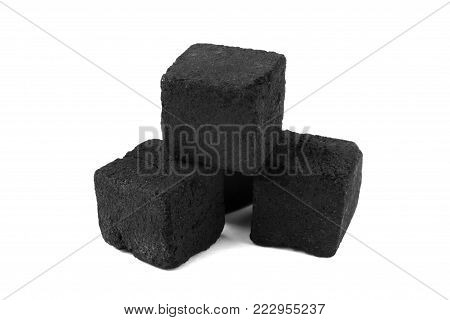 Cubes of coconut coal for a hookah on a white background. Coal for shisha from coconut shell close-up.