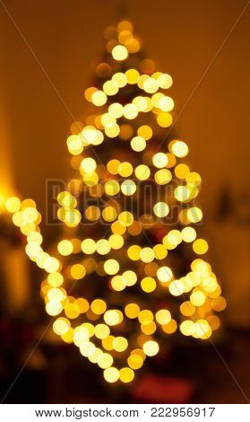 Blurry christmas tree with a beautiful bokeh .
