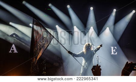 BELGRADE, SERBIA - JANUARY 19TH, 2018: MILLE PETROZZA FROM GERMAN THRASH METAL BAND KREATOR WAVING FLAG OF HATE AT BELGRADE METAL MEETING FESTIVAL