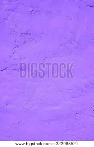 Fragment of wall covered with gypsum with traces of spatula in ultra violet tones, Ultra Violet - Pantone Color of Year 2018, style and fashion
