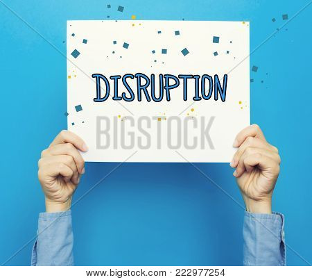 Disruption text on a white poster on a blue background