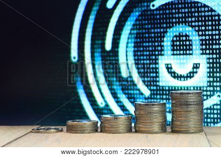 Growing business in safe internet environment. Coin pile stacked into columns of increasing chart shape. Photo of computer screen display with White graphic symbol of a lock.