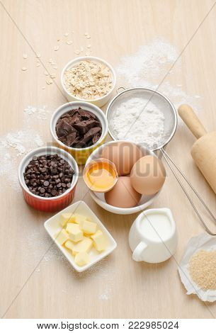 Food ingredient and recipe for baking (cake,dessert and sweet) kitchen utensil and tool on wooden background