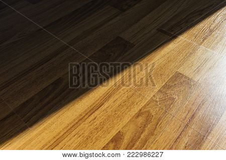 Interior laminated wood floor with light and shadow shade