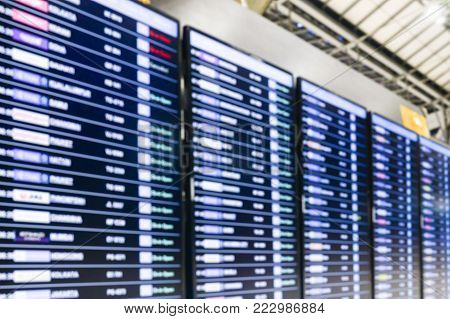 Soft focus of Airport Departure and Arrival information board sign,departures flights information schedule in international airport,travel concept
