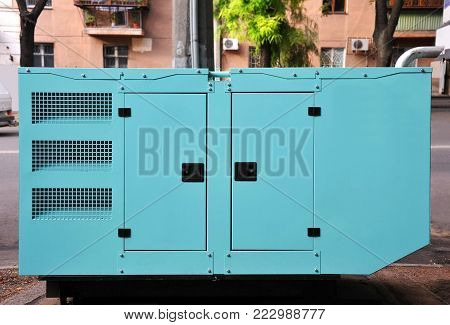 Blue diesel mobil electric generator on street