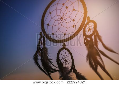 Dream catcher in the wind with beautiful  sunset, Ethnic amulet
