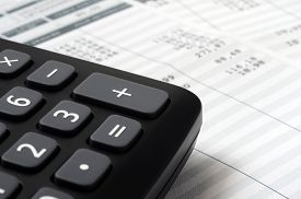 Euro Pay slip and calculator, close up for payroll or salary background