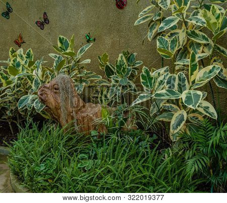 Sejong, South Korea, August 5, 2019: Woodblock Carved To Look Like Animal Sitting Among Plants In Ar