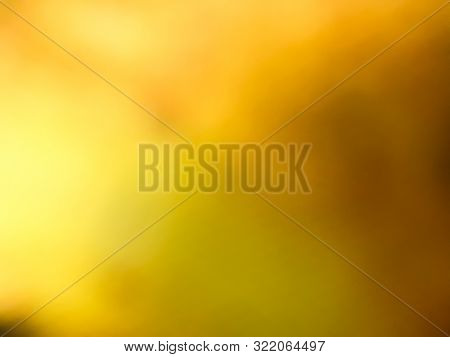 Abstract Blurred Gold Yellow For Background Texture.
