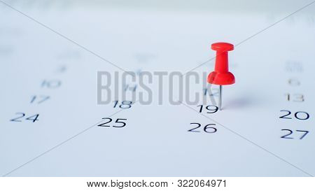 Red Pin Marking On Calendar In Planning Concept.