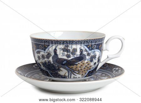 Antique porcelain tableware for tea on a white background