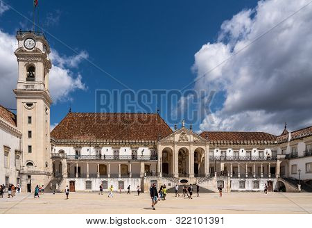 Coimbra, Portugal - 11 August 2019: Tourists Visiting The Main Square Of The University Of Coimbra