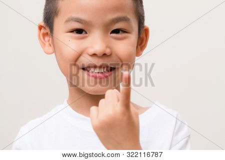 Little kid hold with a contact lens