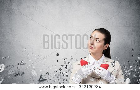 Attractive Woman Holding Vintage Red Phone And Flying Various Letters. Elegant Operator In White Bus
