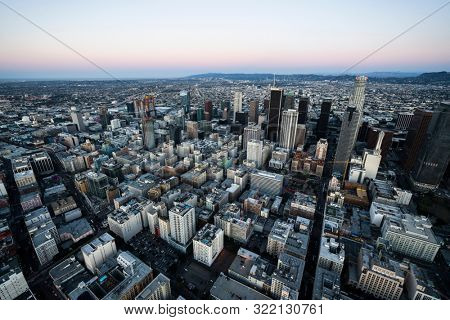Los Angeles, California, USA - February 20, 2018:  Aerial view of urban downtown Los Angeles streets and buildings before sunrise.