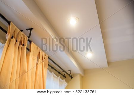 Modern Curtain In Hotel On Warm Feeling. Yellow Curtains, Windows, Multi-level Ceiling.new Real Esta