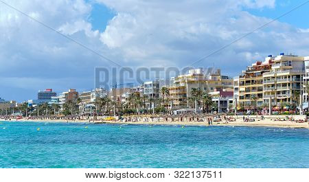 Waterside View El Arenal Touristic Spanish Town, Vacationers Enjoy Warm Weather On Sandy Beach Coast