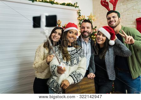 Cheerful Buddies Making Memories While Taking Selfie During Christmas Party At Home