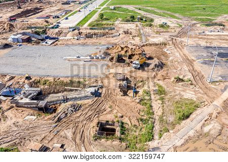 Heavy Industrial Machinery And Equipment On Road Construction Site. New Road Under Construction. Aer
