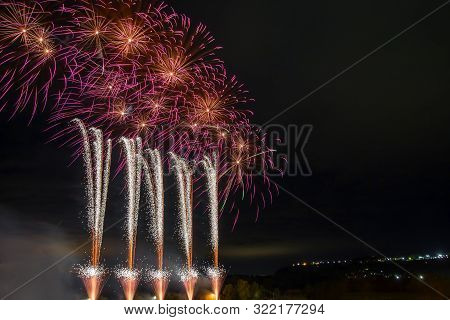 Bright Beautiful Colorful Fireworks, Colored Fireworks Lights In The Night Sky, New Year Holiday Fir